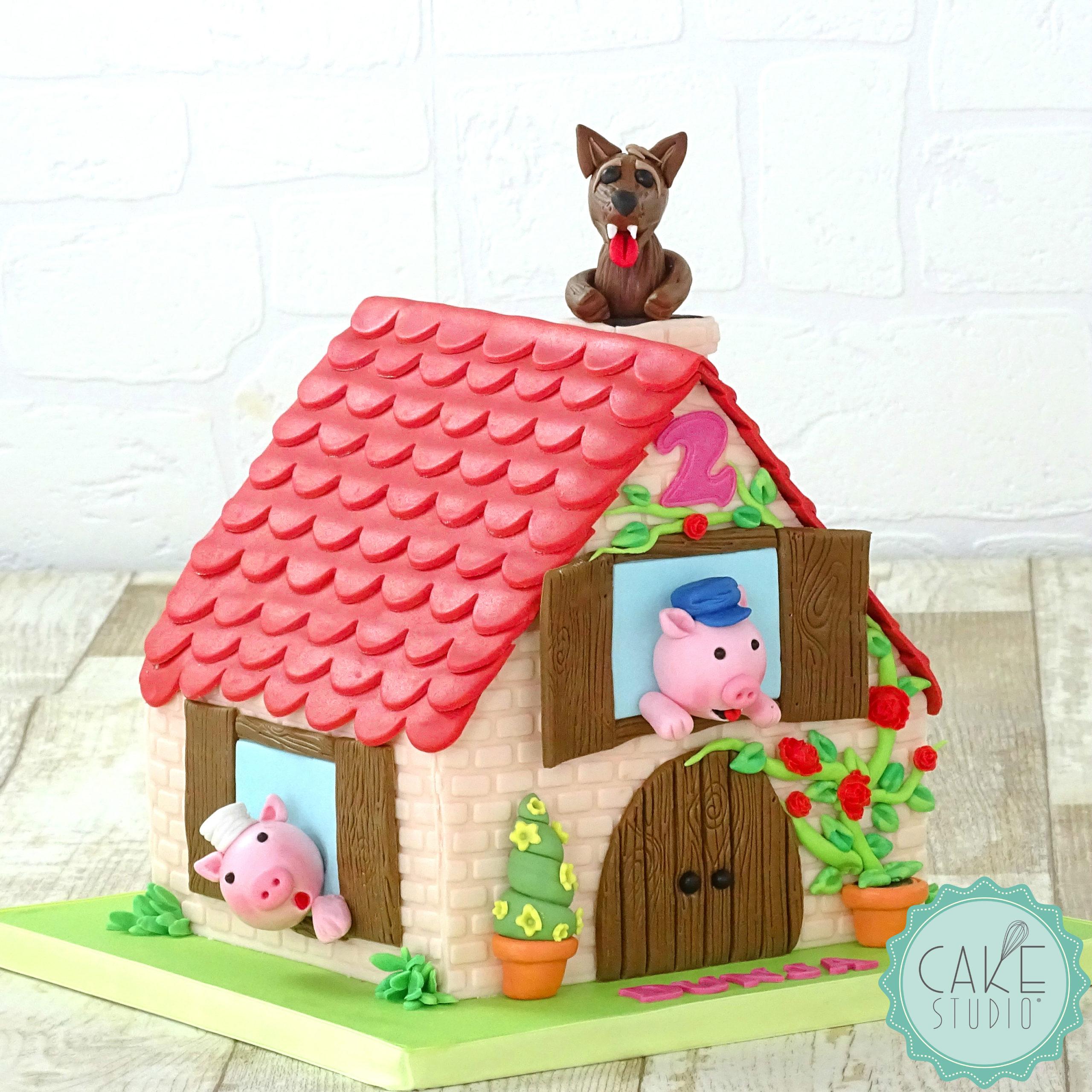 torta a forma di casa dei tre porcellini con lupo