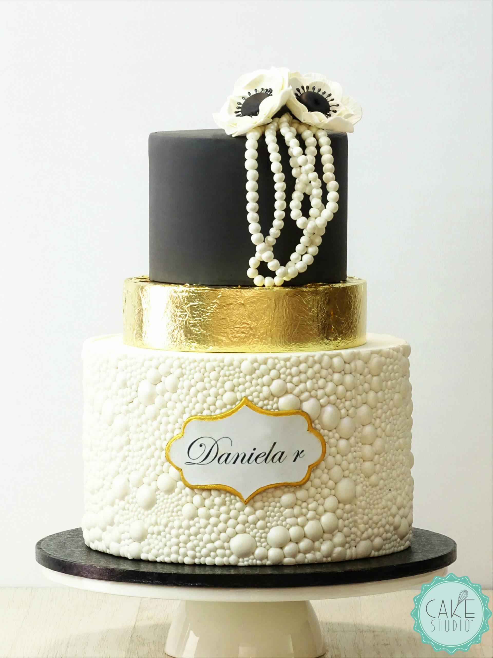 torta perle oro nero per evento inaugurazione gioielleria