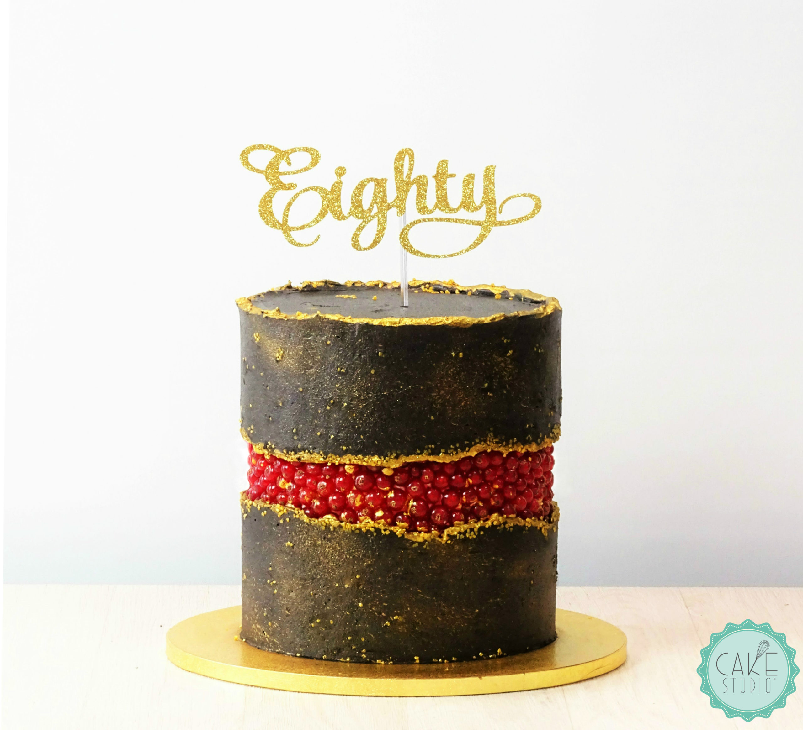 torta compleanno fault line nero oro ribes rosso