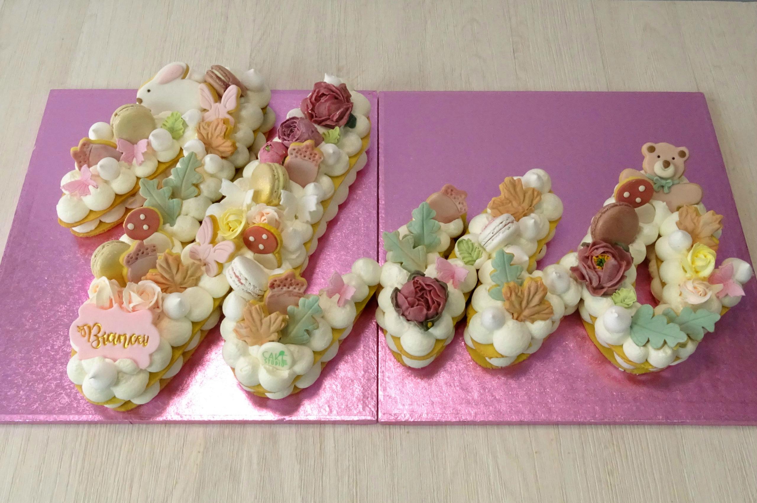 cream tart uno primo compleanno bambina foglie animali funghi fiori