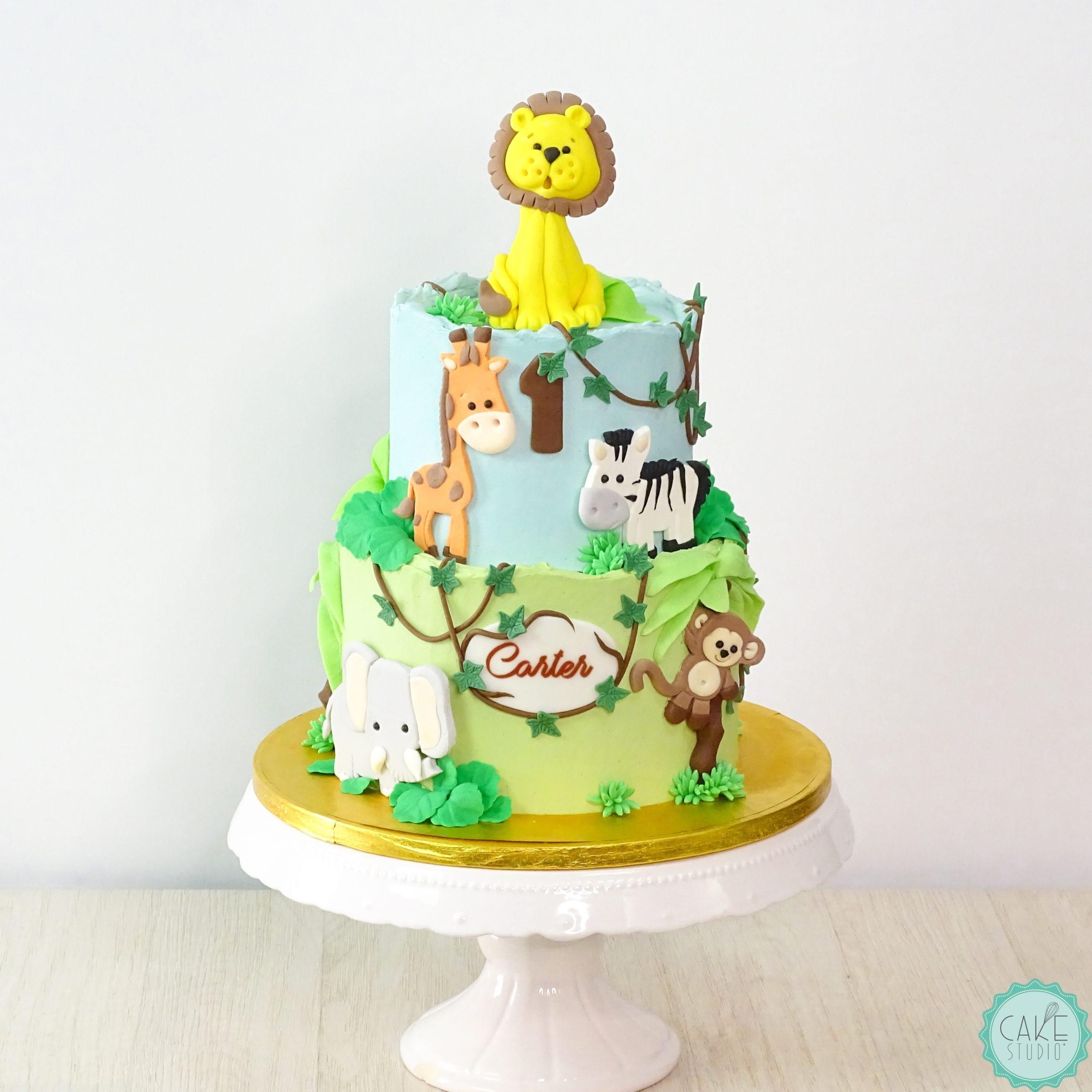 torta primo compleanno bambino elefante leone giraffa zebra scimmia liane palma